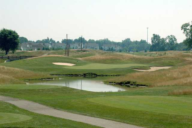 A view of a hole with bunkers and water coming into play at New Albany Links Golf Club.