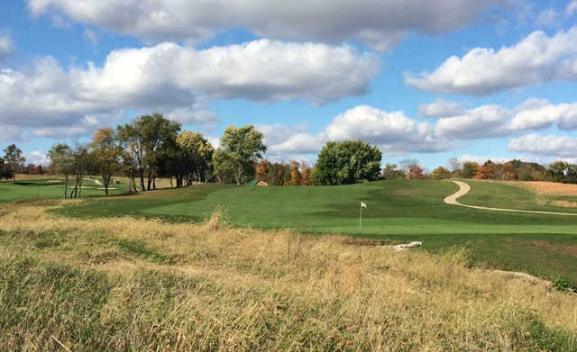 A fall day view of a hole at Majestic Springs Golf Course.